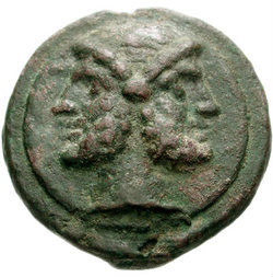 An as, a Roman coin made of heavy bronze from 240-225 BC. showing the head of bearded Janus on a raised disk. Source Classic Numismatic Group Inc. http://www.cngcoins.com/Coin.aspx?CoinID=100279. During the Roman republic, the as showed Janus on one side and the prow of a galley on the other.